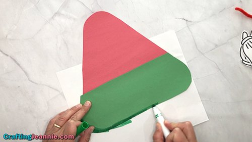drawing details onto the bottom onto the preschool Watermelon craft