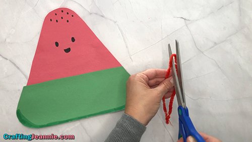 cutting pipe cleaner for the preschool Watermelon craft