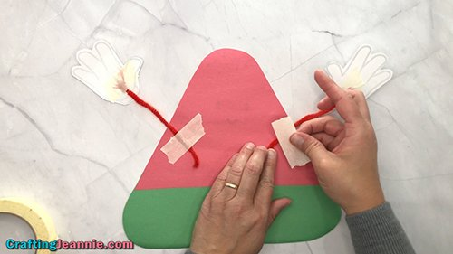 taping the arms onto the preschool Watermelon craft