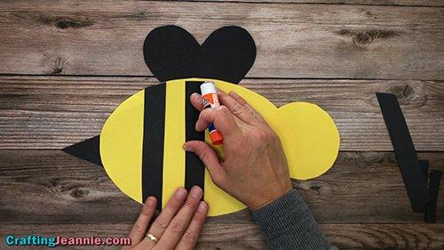 gluing stripes onto bee craft