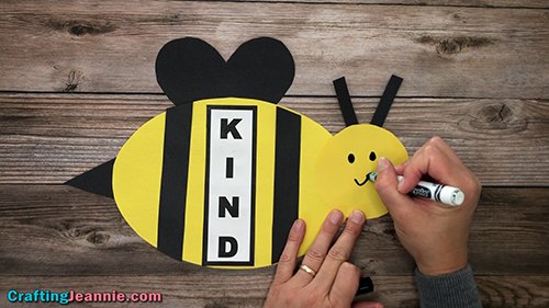 drawing face onto preschool bee craft