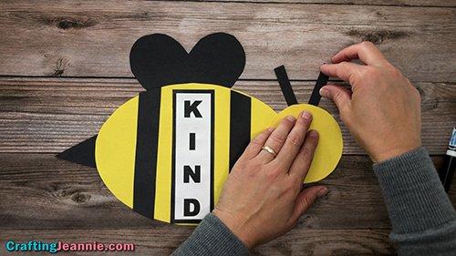 gluing antenna onto preschool bee craft