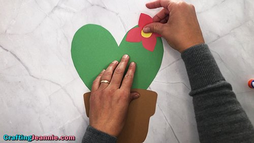 gluing the flower onto the paper heart cactus