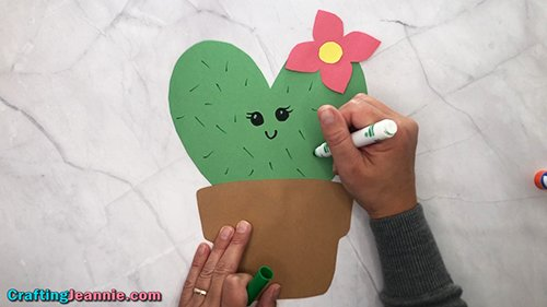 drawing a face onto the heart cactus craft