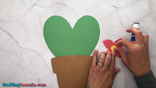 gluing the center of the flower for the heart cactus craft