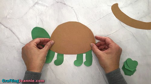 gluing the shell onto the turtle craft