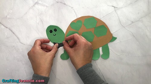 finishing the boy turtle craft