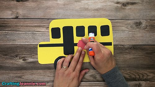 gluing stop sign onto the school bus craft