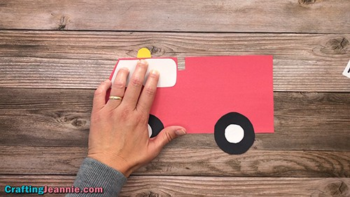 gluing the yellow light onto the Fire Truck craft