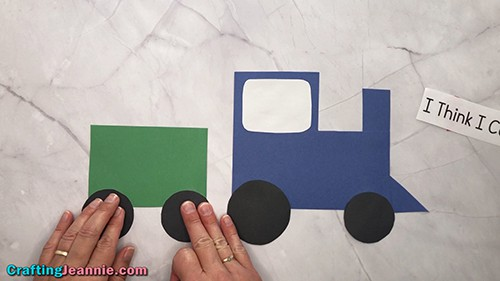 Glue the wheels onto the toddler train craft