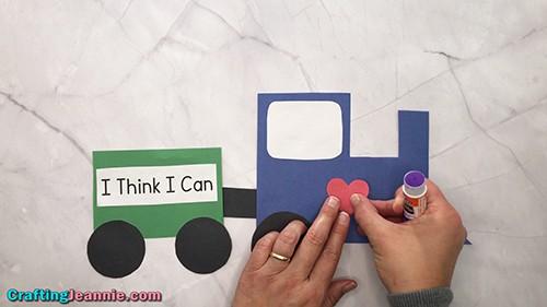 glue a heart onto the paper train craft